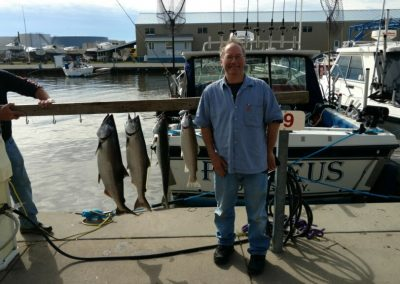 Phil of Boston, MA with his limit catch caught aboard The Proteus out if Oswego